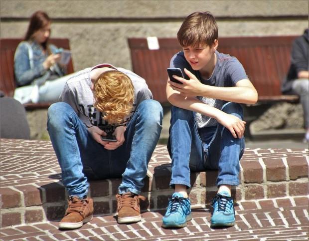 Boys on Mobiles